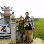Travel Vietnam cemetary cow man