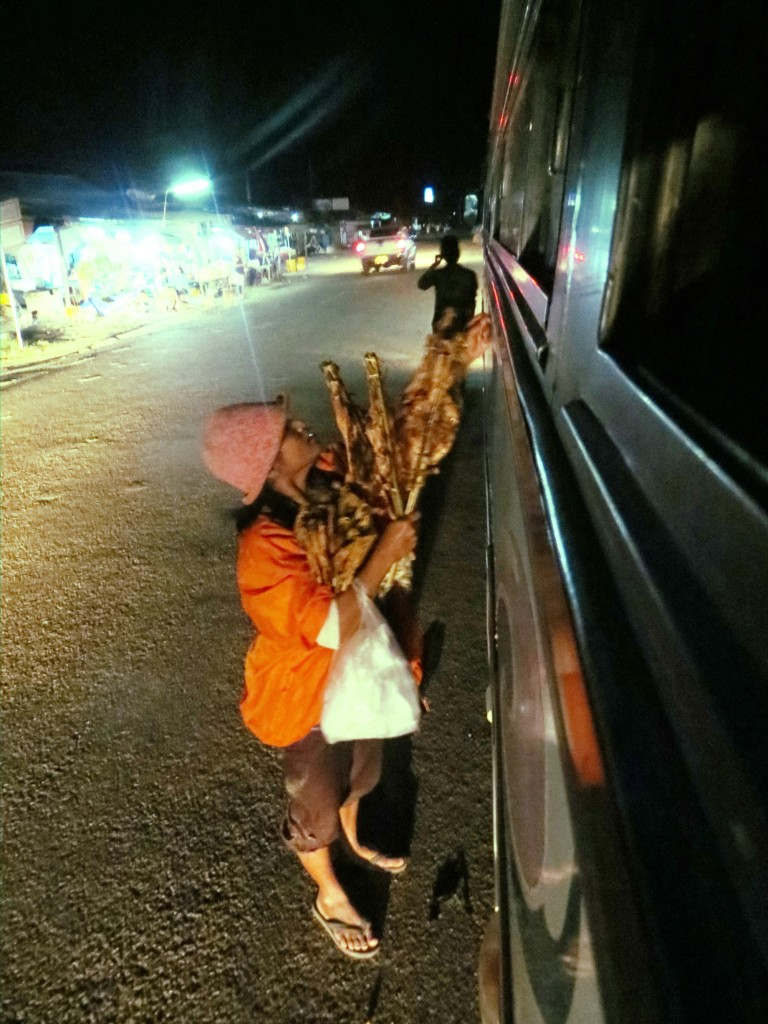 Chicken sellers swarm busses when they pull over